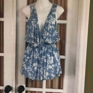 Blue and white romper with lace back